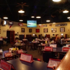 A shot of the restaurant and TVs