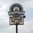 The Claxon Smokehouse sign - Voted Best Ribs by Datebook