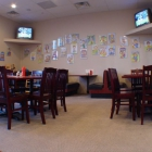 Part of the dining room of Bill's Pizza